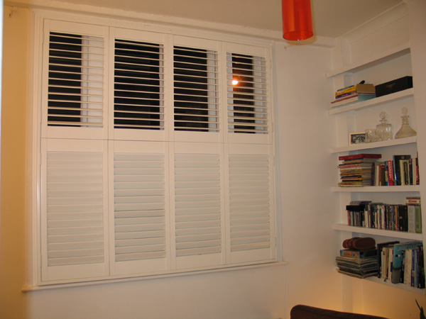 Tier-on-tier plantation shutters in wood, 63mm louvres with hidden tilt rod