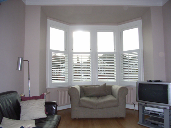 Cafe height plantation shutters, 63mm in wood