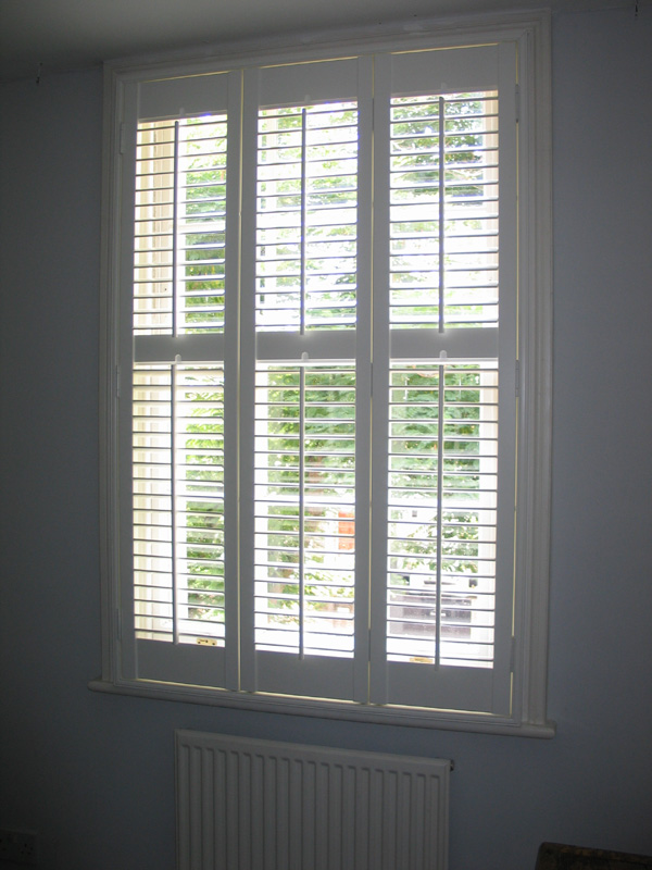Plantation shutters in MDF with 63mm louvres