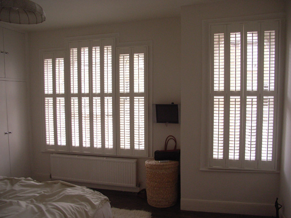 Plantation shutters in MDF with 47mm louvres