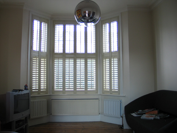 Bi-fold, tier-on-tier, plantation shutters with 47mm louvres in MDF