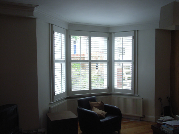 Plantation shutters in wood with 63mm louvres