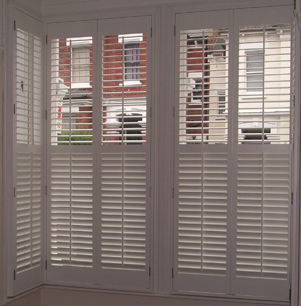 Plantation shutters in wood, 63mm louvres and mid-rail for seperate control top and bottom