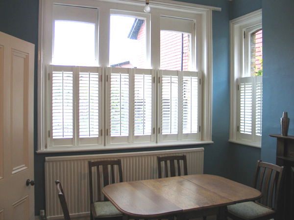 Cafe Height Plantation Shutters, with 47mm louvres, installed by Select Shutters in North London
