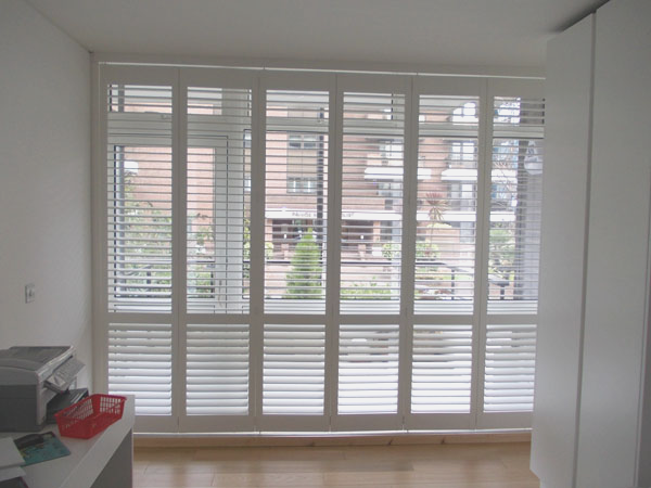Full Height Plantation Shutters with track for balcony door in Central London installed by Select Shutters