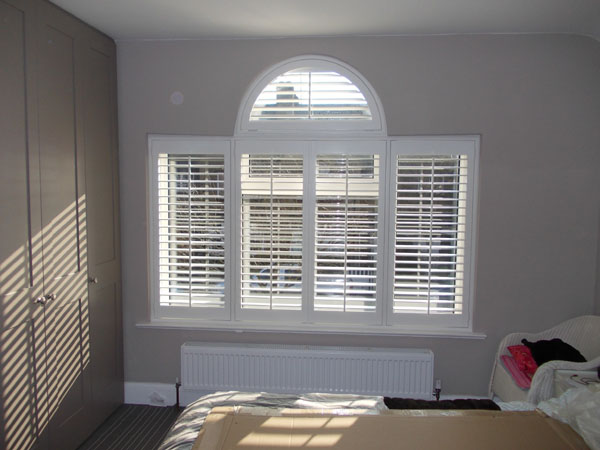 Palladian window with plantation shutters
