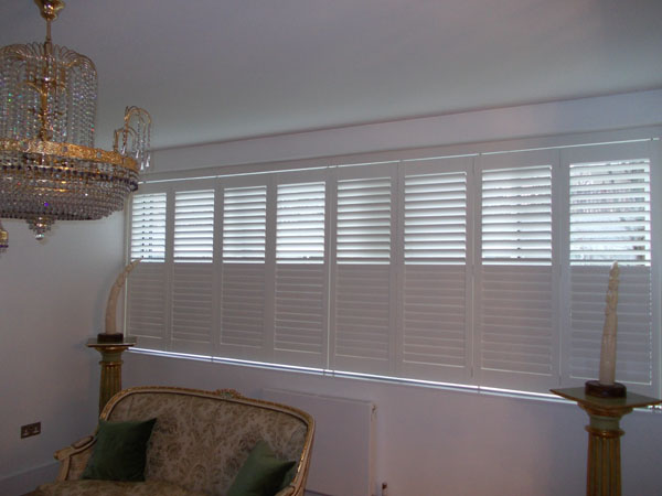 Plantation Shutters for wide windows with tracking systems in Central London