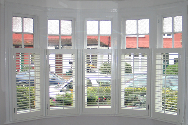 Silk white plantation shutters in wood with 47mm louvres