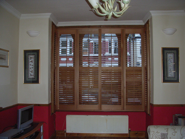 Plantation shutters in oiled cedar with 63mm louvres