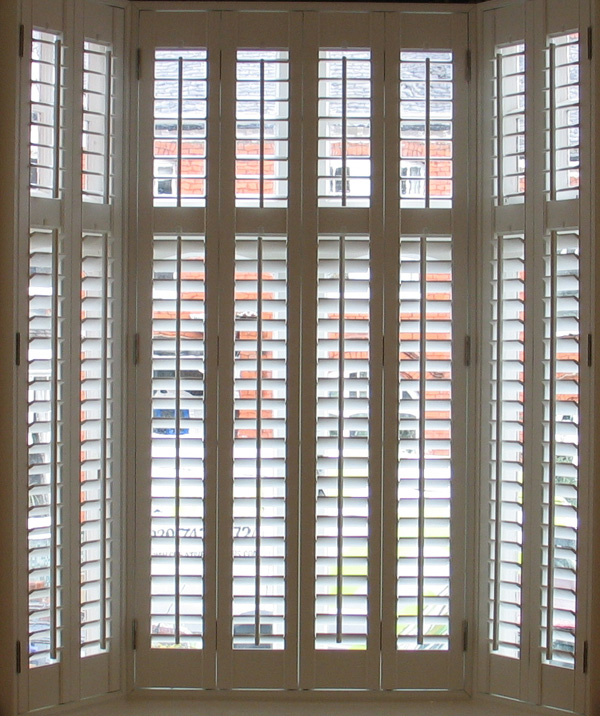Silk white plantation shutters in wood with 63mm louvres internal and external shots